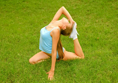 young woman doing exercises Stock Photo - 5361463