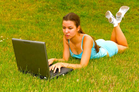 girl with notebook in park Stock Photo - 5361436