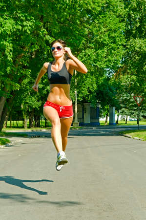 woman running in the park photo