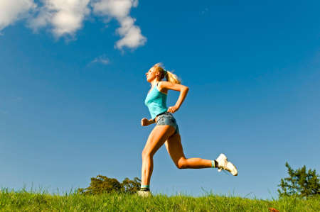 young woman running on the grass Stock Photo - 5626042