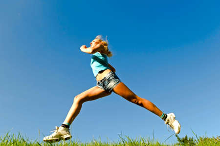 young woman running on the grass Stock Photo - 5626021