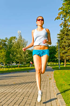 young woman running in the park Stock Photo - 5642123