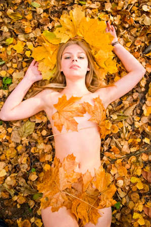 young beautiful woman with maple leaves Stock Photo - 5766178