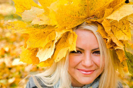 portrait of young woman with maple garland Stock Photo - 5785847