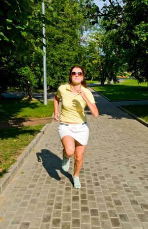 Brunette girl jogging in the park Stock Photo - 5894637
