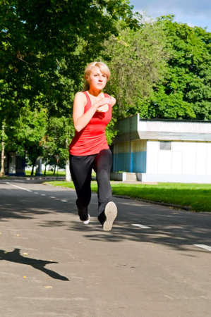 Young blonde woman running in park Stock Photo - 6015805