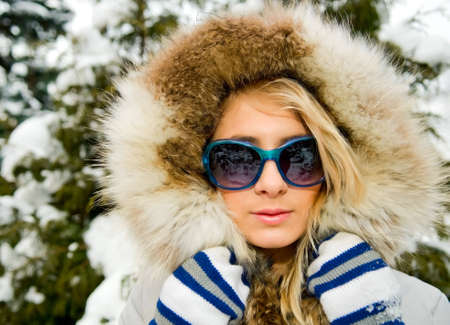 Young blonde woman in winter park photo