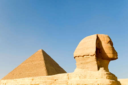 the Great Sphinx and Khufu pyramid of Giza, Egypt photo