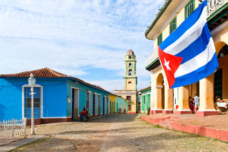 The street of Trinidad with flag of Cuba