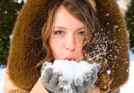 portrait of young smiling woman with snow photo