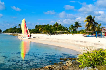carribean: the carribean coast, tropical beach with catamaran, Ancon, Cuba Stock Photo