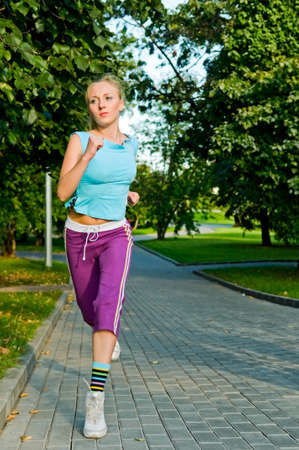 young woman running in park Stock Photo - 6501984