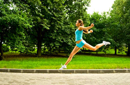 young woman running in park Stock Photo - 6611766