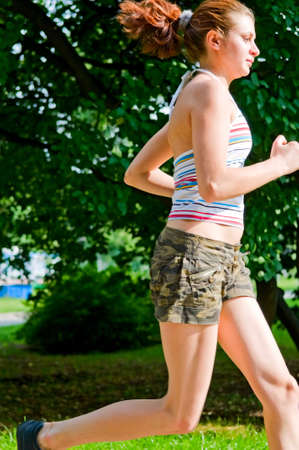 young woman running in park Stock Photo - 6676220