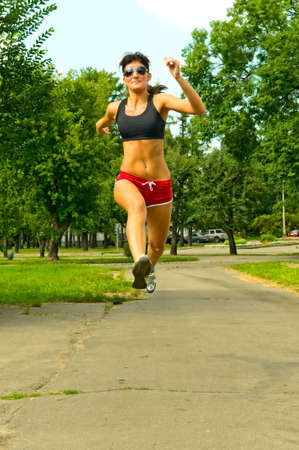 young woman running in the park photo