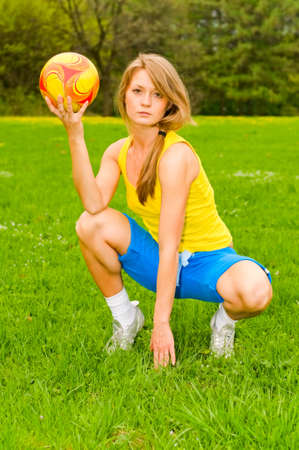 attractive young woman with football photo