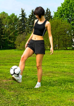young woman playing with ball Stock Photo