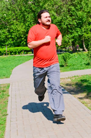 smiling man running in the park photo