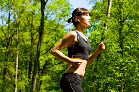 young woman running in park Stock Photo
