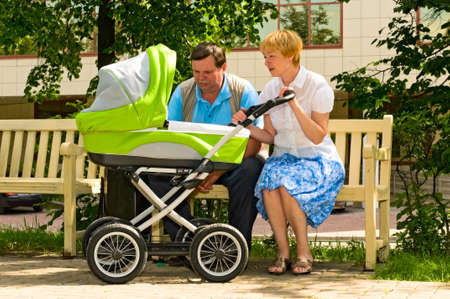 mature couple with baby carriage Stock Photo - 7273154