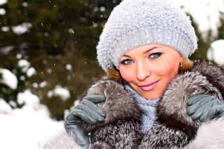 Pretty young woman in winter park Stock Photo