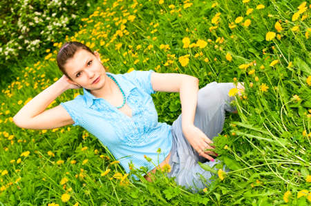 young woman resting on the grass Stock Photo - 7334674