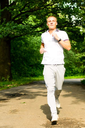 young man jogging photo