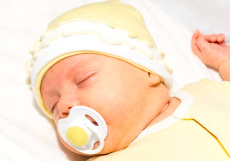 close-up portrait of sleeping baby with dummy photo