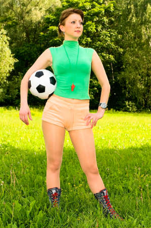 young woman with ball and whistle photo