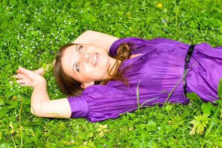 smiling girl on meadow photo