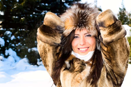 pretty young woman in winter forest Stock Photo - 7587993