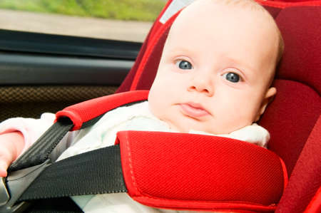 child in car safety seat  photo