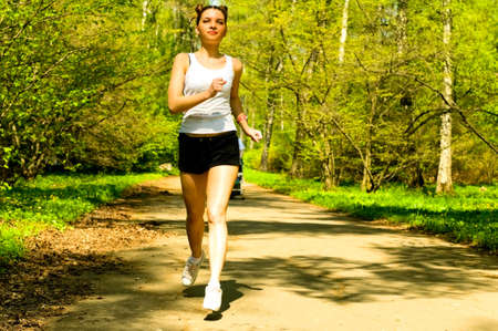 pretty young woman jogging in park Stock Photo - 7842605