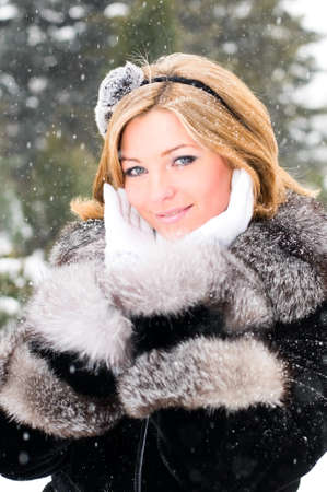pretty girl in winter forest photo