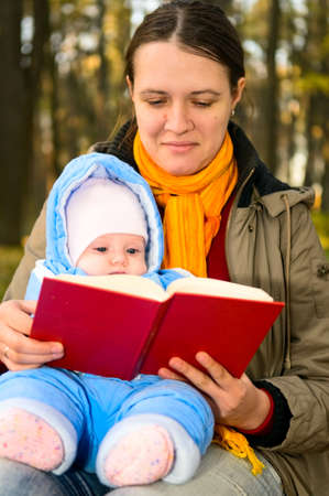 mother with baby girl reading book Stock Photo - 7942136