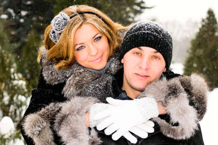 couple winter: loving young couple in winter forest Stock Photo