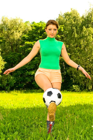 young woman playing soccer photo