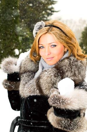 pretty caucasian girl in winter forest photo