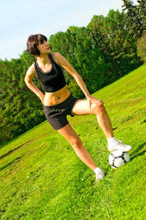 girl with soccer ball photo