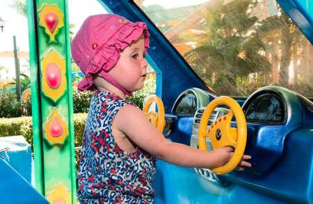 carrousel: Baby girl playing Stock Photo