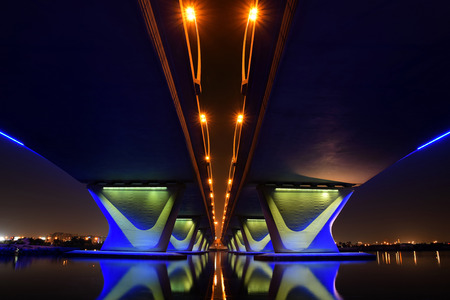 long: Garhoud Bridge from base at night with long exposure Stock Photo