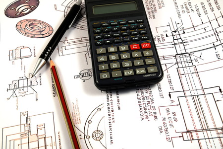 map pencil: Scientific calculator Pen and Pencil over the Engineering Drawing Map