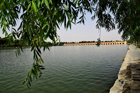 esfahan: View from Siosepol with trees Siose Bridge in Esfahan Iran Stock Photo