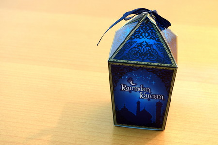 beside table: Dates Box beside Table Lamp for Ramadhan Stock Photo