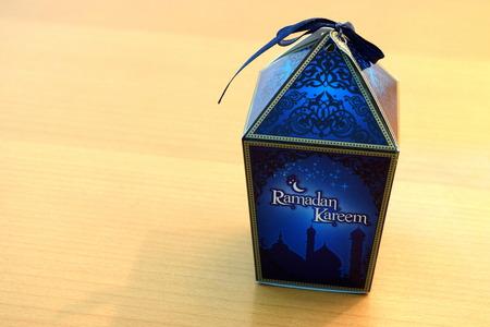 ramadhan: Dates Box beside Table Lamp for Ramadhan Stock Photo