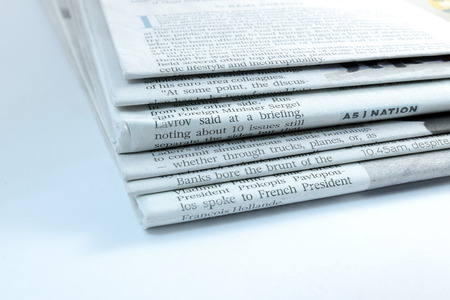 newspaper stack: Stack of newspapers on white background