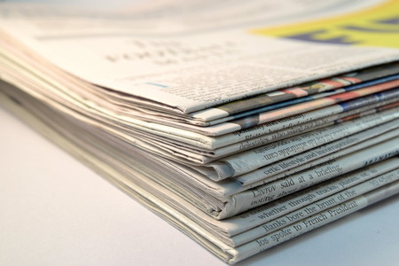 Close-up Stack of newspapers on white background Stock Photo