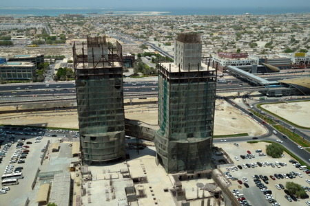 rta: Under construction building in Business Bay Dubai with metro station view Stock Photo