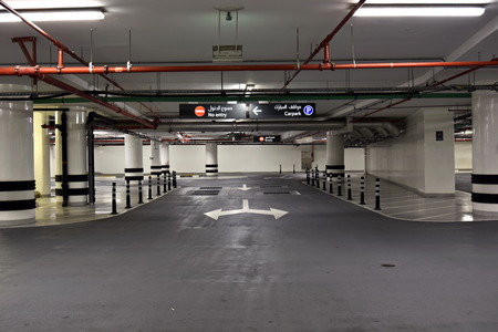 carpark: At the Basement Parking, carpark with signboard and details,Dubai, United Arab Emirates Editorial