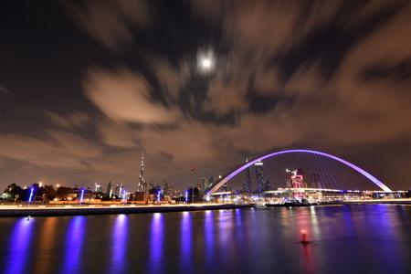 tallest bridge: Dubai Skyline at night from new Dubai Canal, U.A.E Stock Photo